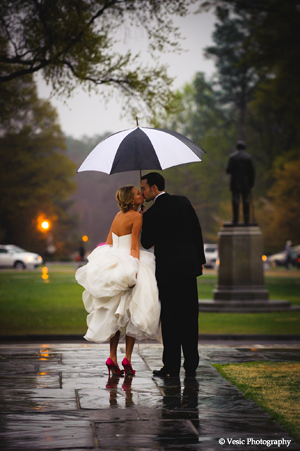 Duke Chapel Bride and Groom Kissing in the Rain