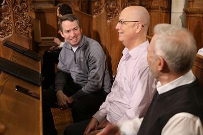 Dr. Walker Robinson (left) talks with fellow choir members before a choir rehearsal.