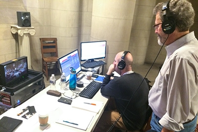 """Audio engineer Mark Donahue (left) and producer Blanton Alspaugh monitor a recording of """"The Marvel of This Night"""" from the chapel's crypt."""