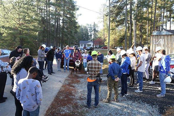 Duke and community volunteers gather to celebrate and bless a Habitat for Humanity house