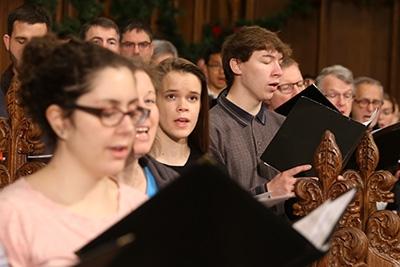 Senior Ellie Sweezy (center) sings during a choir rehearsal.