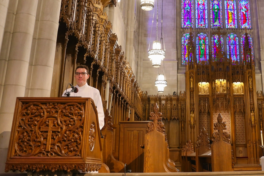 Jonathan Avendano, T '21, serving as a lector at the Chapel.