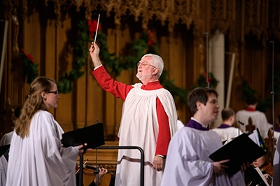 Chapel Associate Conductor Philip Cave directs congregational singing. He contributed an original arrangement to the service.