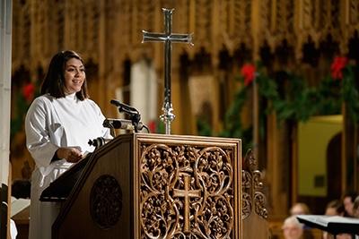 Nohemi Ramirez, a staff specialist in the Divinity School Chaplain's Office, reads from the Gospel of Luke.
