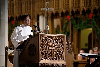 Boy Purba, a graduate student in the Sanford School, reads from the Gospel of Matthew.