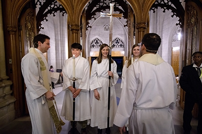 """The Rev. Bruce Puckett (left), assistant dean at Duke Chapel, and Dean Luke A Powery (right) talk with students at the end of """"The Marvel of This Night"""""""